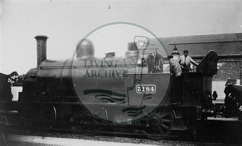 Steam Engine 3184 - Saddletank - and the engine crew at Bletchley Station. Illustrative photograph supplied by kind permission of BCHI (Accession Ref: BLE/P/416). Original donated by Robin Brown.