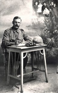 Photo of Dickie Hawes at a desk