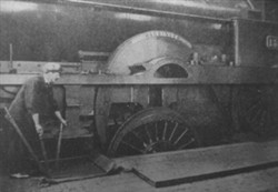 Photograph of a train with worker