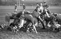 Photograph of Bletchley RFC players in a scrum in a match in 1977