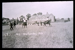 Slide of fencing on horseback.