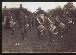 Slide of a military band on parade.