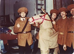 Photograph of four men dressed as soldiers and a costume horse.