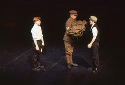 Slide of a sergeant handing out uniform