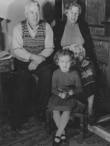 Photograph of elderly couple with a young girl