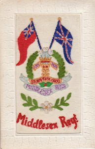 Embroidered postcard showing Middlesex Regiment badge