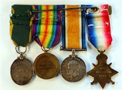 Four medals mounted on a bar