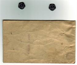 Two roses in brown envelope
