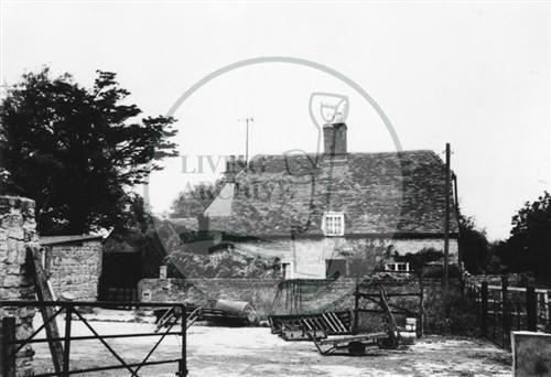 Photograph of farm and farmyard (1971).