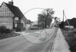 Photograph of road with cottages in Woolstone (1971).