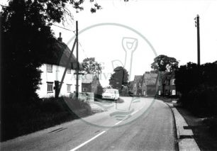 Photograph of road and Crossed Keys pub in Woolstone (1971).