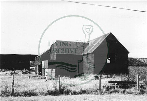 Photograph of farm buildings at Woolstone (1971).