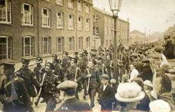 Soldiers marching outside McCorquodales Wolverton.