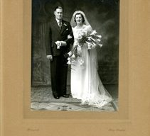Official wedding photograph of Frank Brown and Beryl Taylor in a studio.