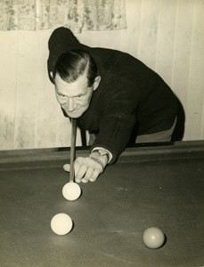 Photograph of Frank Brown playing billiards.