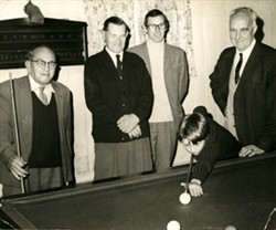 Photograph of billiards players.