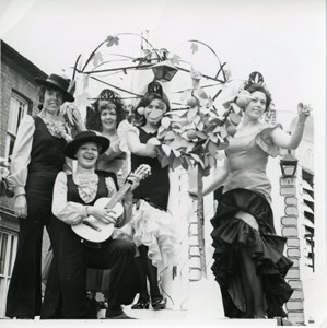A carnival float of women in Spanish costumes.