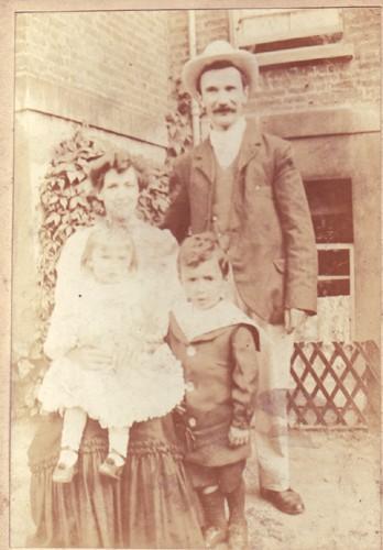 A family group in a garden.