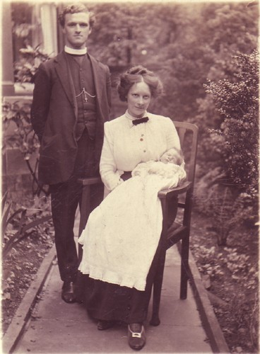 A vicar with his wife and baby.