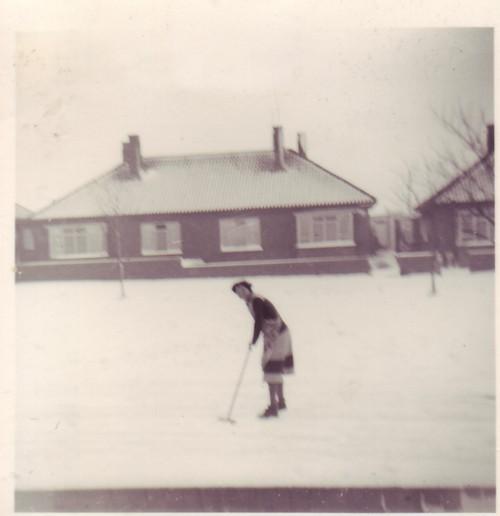 Beryl Brown clearing snow.