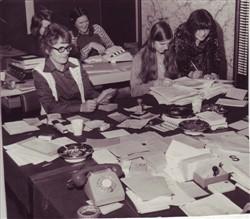 Women getting postal votes organised.