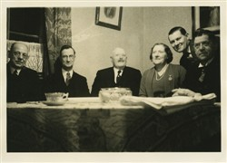 The Browns and Wildmans in the drawing room of the Firs.