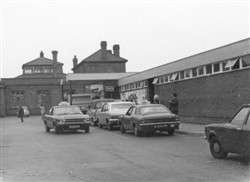 Bletchley Railway Station 1972 (the building on the left is the Post Office sorting office).   Illustrative photograph supplied by kind permission of Bletchley Community Heritage Initiative (Accession Ref: BLE/P/1681).