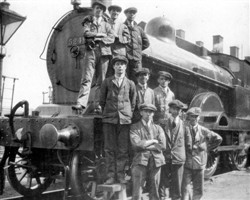 Bletchley LMS cleaners pose with the 1923 82-tonner engine no.5249, 1925.   Illustrative photograph supplied by kind permission of Bletchley Community Heritage Initiative (Accession Ref: BLE/P/1124).