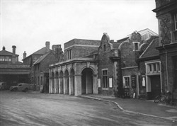 Bletchley Station entrance with Post Office and Coffee Tavern in left hand corner c.1950s  (Accession Ref: RWS/P/229).