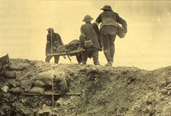 Slide of a photograph of soldiers carrying a casualty on a stretcher
