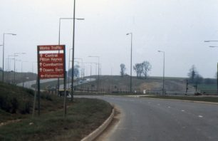 A carriageway with works directional sign