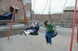 Two little girls on swings in Eaglestone