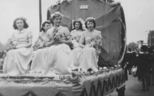 Carnival Queen & attendants on float.