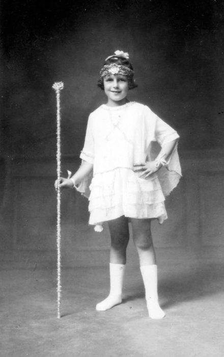 Girl in costume for Charlie Scott's Pantomime.