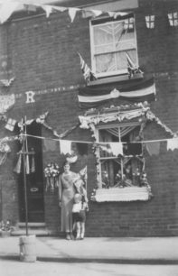 Sylvia Mead's mother outside 47 King Edward Street, New Bradwell. Silver Jubilee May 1935.