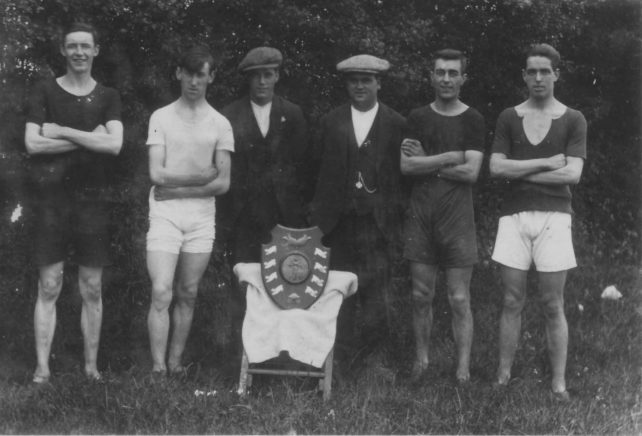 Swimming team with trophy.