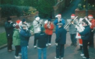 Bradwell Silver Band, performing outdoors at Christmas.