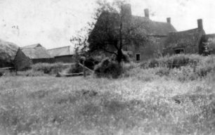 House and outbuildings.