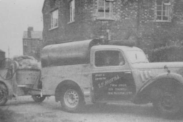 E P Hiorns (Builder & Contractor) pickup truck towing a cement mixer.