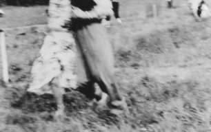 Young couple running in a field.