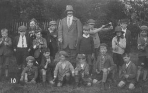 The Poachers group. A group of boys with catapults (and a moustachioed man).