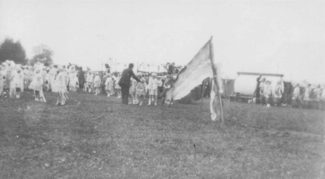 Groups of children dressed up in a field