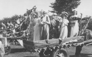 Carts decorated for a parade, one with children holding drinks