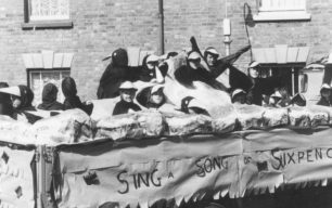 """Parade float titled """"Sing a Song of Sixpence"""" with a group of children dressed up as blackbirds ."""