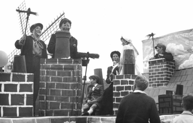 Parade float with chimneys and chimney sweeps