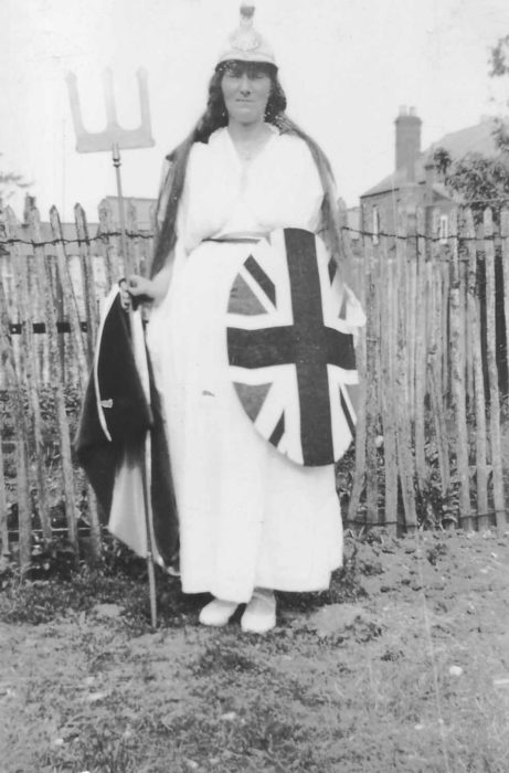 A woman dressed up as Britannia (with trident