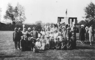 A group of 24 children dressed up in various costumes