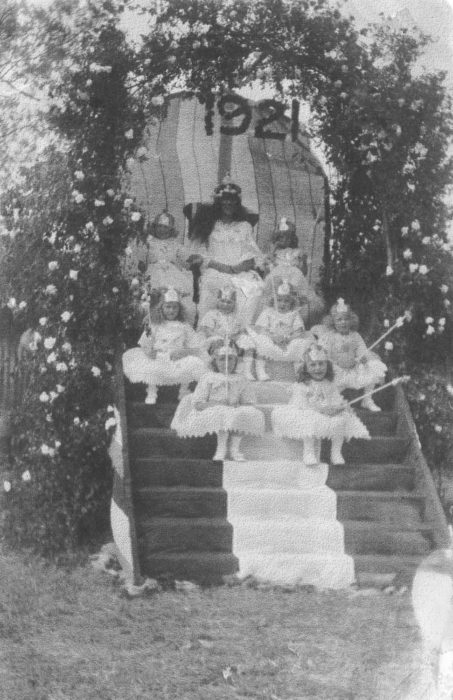 1921 carnival group sitting on a stepped podium