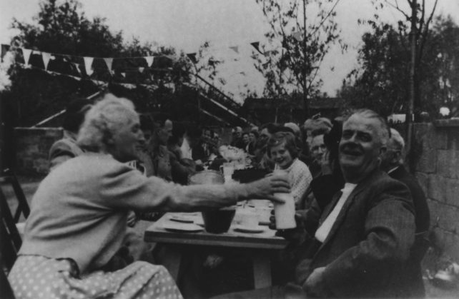 Enjoying the tea party for the 1953 Coronation