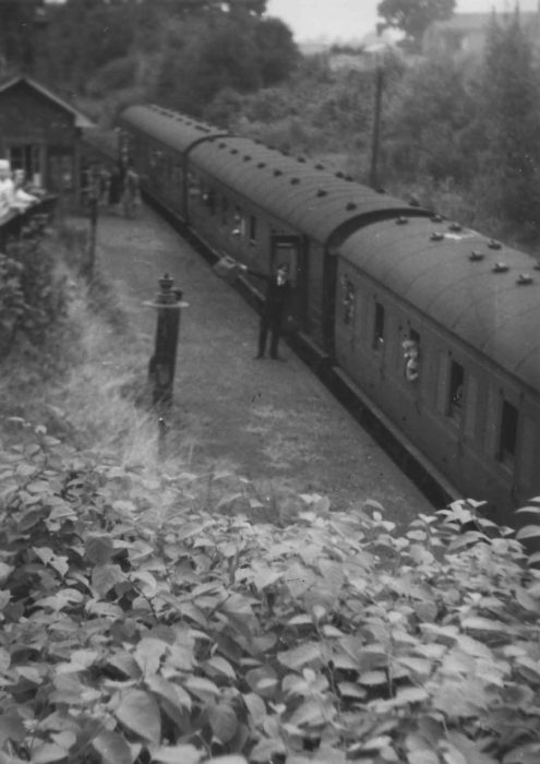 The Guard waves off the Last Train at Bradwell Station